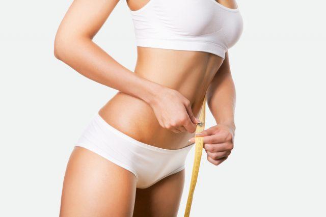 Женщина с сантиметром